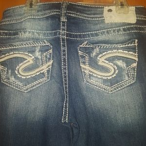 Silver jeans.